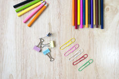 Office and arte stationery objects on wood table with a notebook Royalty Free Stock Image