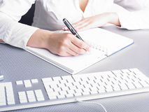 Office Assistance writing Shedule Stock Image