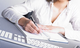 Office Assistance writing Shedule Stock Photo