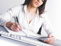 Office Assistance writing Shedule Stock Photography