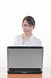 Office Assistant in front of laptop Royalty Free Stock Images