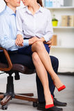 Office assistant is sitting on coworkers lap Stock Photography