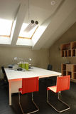 Office in the attic. With windows Royalty Free Stock Images