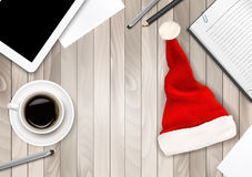 Office Background with Santa Hat, Tablet and Office Supplies. Stock Photos