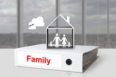 Office binder family holding hands in house Stock Photography