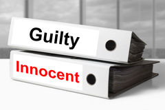 Office binders guilty innocent. Stack of white office binders guilty innocent Royalty Free Stock Image