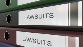 Office binders with Lawsuits tags 3D rendering. Line of multicolor office binders with Law suits tags 3D Stock Image