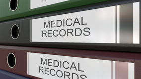 Office binders with Medical records tags 3D rendering. Line of multicolor office binders with Medical records tags 3D Royalty Free Stock Photo