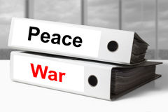 Office binders peace war Royalty Free Stock Photo