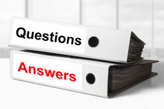 Office binders questions answers. Stack of two white office binders question answers Royalty Free Stock Photos