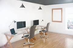 Office with blank screens Stock Photo