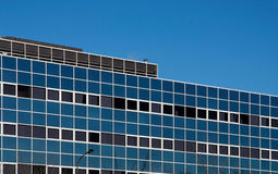 Office block. Square windows of a city office block stock photography