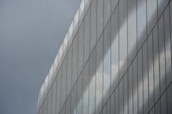 Office block with dark cloud Stock Photos