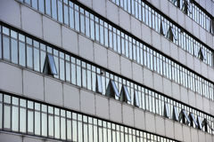Office block. Detail of the facade of an office block with open windows Stock Photo