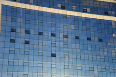 Office block. Detail of a glass-fronted office block with contents of offices faintly visible behind the glass. Suitable as abstract background Royalty Free Stock Image