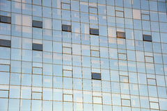 Office block. Detail of a glass-fronted office block with contents of offices faintly visible behind the glass. Suitable as abstract background Stock Photos