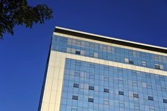 Office block. An office block stands out against a clear blue sky Stock Photography