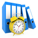 Office blue folders and alarm clock isolated on. White background Stock Photos