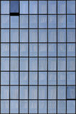 Office blue windows. Grid of office blue windows with curtains Stock Image