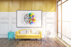 Office break room city veiw. Whiteboard with sketch of brain on it. Blue coffe table in corner. Large yellow sofa by its side. Concept of comfortable Stock Photography