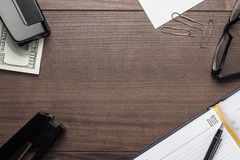 Office brown wooden table with some objects Royalty Free Stock Image