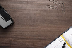 Office brown wooden table with some objects Royalty Free Stock Images