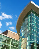 Office Building. Reflective glass office building on a sunny day stock photography