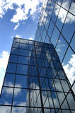 Office Building. Reflecting sky and clouds Royalty Free Stock Photos