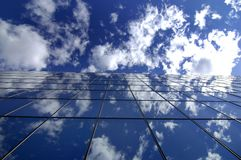 Office Building. Reflecting sky and clouds Stock Photo