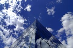 Office Building. Reflecting sky and clouds Stock Images