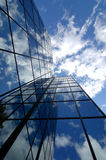 Office Building. With blue sky and clouds reflecting Stock Photos