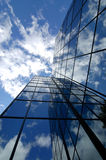 Office Building. With blue sky and clouds reflecting Stock Images