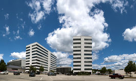 Office building. With cool looking clouds royalty free stock photo