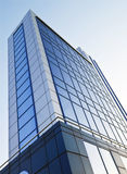 Office building. Office building on a blue stylish color of glass windows, with clear blue sky Royalty Free Stock Images