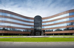 Office building. Exterior in brick and glass with a blue sky Royalty Free Stock Image
