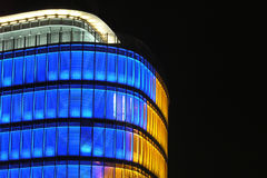 Office building. Modern office building with lights at night stock images