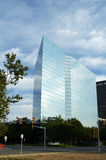Office Building. Clouds reflecting in the glass structure of a bank building Stock Image