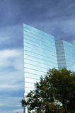 Office Building. Clouds reflecting in the glass structure of a bank building Stock Photography