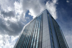 Office building. Big office building with blue sky and white clouds stock images