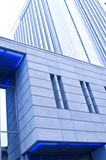 Office Building. Blue tinted close up of office building Royalty Free Stock Photo