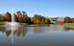 Office Building. In Front of a Lake in the Autumn Season Stock Photo