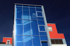 Office Building. An office building with a blue glass facade Royalty Free Stock Photos