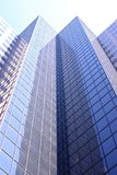 Office Building. Looking up at the sides of tall office buildings Stock Photography