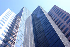 Office Building. Looking up at the sides of tall office buildings Stock Images