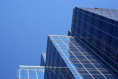Office Building. Looking up at the sides of tall office buildings Royalty Free Stock Photos