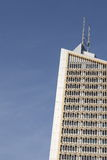 Office building. Modern office building exterior under clear blue sky Stock Image