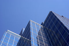 Office Building. Looking up at the sides of tall office buildings Stock Photos