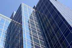 Office Building. Looking up at the sides of tall office buildings Stock Image