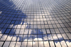 Office building. Glass wall of business center and sky reflection Stock Photography