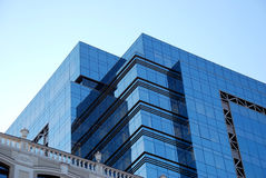 Office building. With glass windows and blue sky background Stock Photos